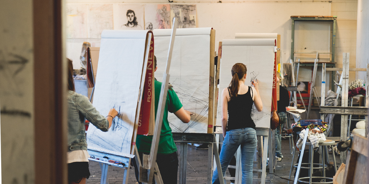 Students drawing at easels in the studio